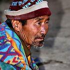 Elderly Man in a Bright jacket. Bhutan, Eastern Himalayas  by Carole-Anne