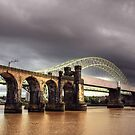 A dark sky and the two bridges  by Jon Baxter