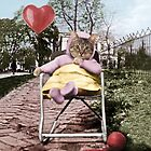 Pretty little Kitty with a heart balloon by PETER GROSS