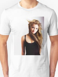 Beautiful young girl with windswept hair T-Shirt