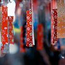 Strips of hanging Japanese paper; Asakusa, Tokyo, Japan by Alfie Goodrich