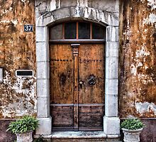 Old entrance door by jean-louis bouzou