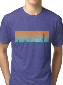 Penguin in the desert Tri-blend T-Shirt