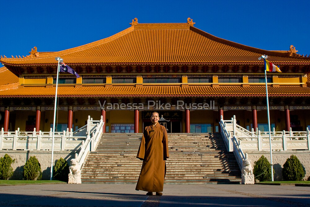 Nan Tien Buddhist Temple - Ven. Ru Yi in front of stairs leading up to main shrine by Vanessa Pike-Russell