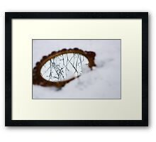 Ornate mirror in the snow Framed Print