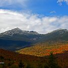 First Snow and Peak Fall Foliage by lloydsjourney