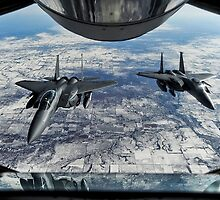 F-15E Strike Eagles wait to receive fuel from a KC-135R Stratotanker by spitfirebbmf