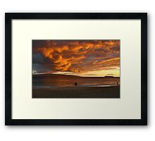 Surfers at Dusk Framed Print