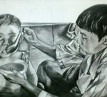 boy feeding his younger brother by ramya kapula