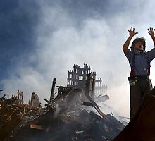 A New York City fireman calls for 10 more rescue workers to make their way into the rubble of the World Trade Center in New York city.  by U.S. Navy by Adam Asar