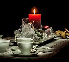 Christmas still life composition on a black background by enolabrain