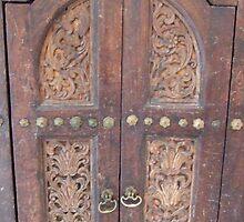 Wooden door in Tunisia by DeborahDinah