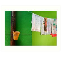 Vase, towels and green wall Art Print