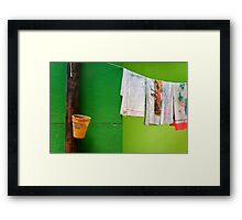 Vase, towels and green wall Framed Print