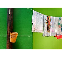 Vase, towels and green wall Photographic Print
