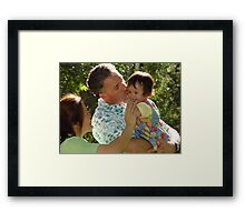 A Daddy's Kiss Framed Print