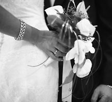 Bride and groom holding black and white wedding photograph by edwardolive