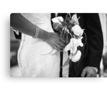 Bride and groom holding black and white wedding photograph Canvas Print