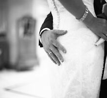 Groom holding bottom of bride black and white wedding photograph by edwardolive