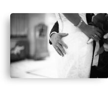 Groom holding bottom of bride black and white wedding photograph Canvas Print