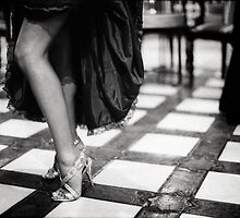 Sexy legs of female guest in party black and white wedding photograph by edwardolive