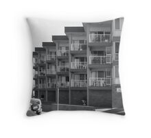 apartment block by the sea Throw Pillow