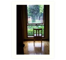 Chair at window looking out Art Print