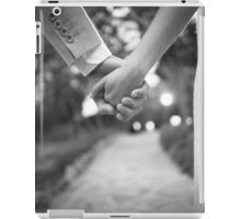 Groom holding hands with bride black and white wedding photograph iPad Case/Skin