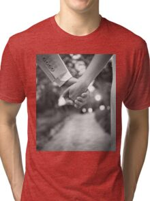 Groom holding hands with bride black and white wedding photograph Tri-blend T-Shirt