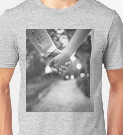 Groom holding hands with bride black and white wedding photograph Unisex T-Shirt