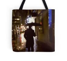 Man walking in street at night in rain color 35mm analogue photojournalism portrait photograph Tote Bag