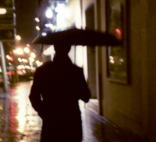 Man walking in street at night in rain color 35mm analogue photojournalism portrait photograph Sticker