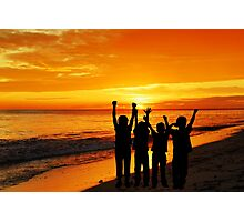 Children silhouettes on a  sunset beach Photographic Print