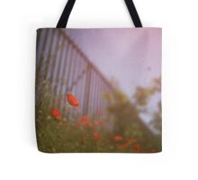 Poppies growing up fence in hot summer faded vintage retro square Hasselblad medium format film analog photo Tote Bag