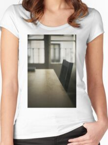 Wooden table desk and chair in empty room with window behind in beige brown colors artistic color digital photograph Women's Fitted Scoop T-Shirt