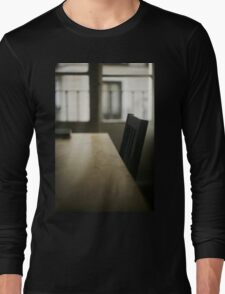 Wooden table desk and chair in empty room with window behind in beige brown colors artistic color digital photograph Long Sleeve T-Shirt