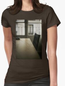 Wooden table desk and chair in empty room with window behind in beige brown colors artistic color digital photograph Womens Fitted T-Shirt