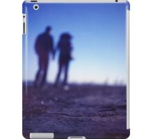 Romantic couple walking holding hands on beach in blue Medium format color negative film photo iPad Case/Skin