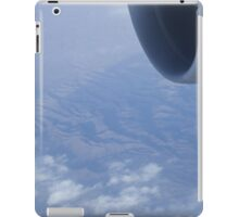Jumbo jet airplane wing engine in flight flying over mountains and blue sky photograph iPad Case/Skin