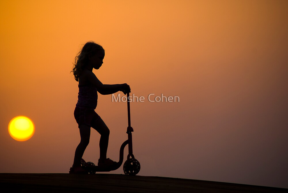Child on a scooter by Moshe Cohen