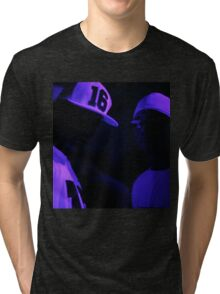 Hip hop rap gangster rappers singers at night in dark nightclub bar lit in pink black light wearing baseball caps Tri-blend T-Shirt