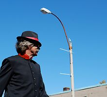 man on stilts in parade by colleenboston