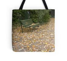 Bench in sea of leaves Tote Bag