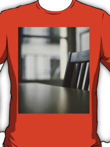 Wooden table desk and chair in empty room with window behind in beige brown colors artistic color digital photo T-Shirt