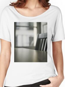 Wooden table desk and chair in empty room with window behind in beige brown colors artistic color digital photo Women's Relaxed Fit T-Shirt