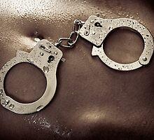 Shiny handcuffs on wet naked woman body art photo print by ArtNudePhotos