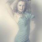 Beautiful young blonde girl in blue dress by Ryan Jorgensen