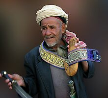 JAMBIYA SELLER - YEMEN by Michael Sheridan
