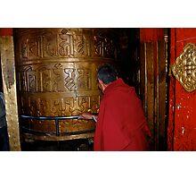 prayer wheel and monk Photographic Print