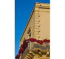 a balcony with flowers Photographic Print